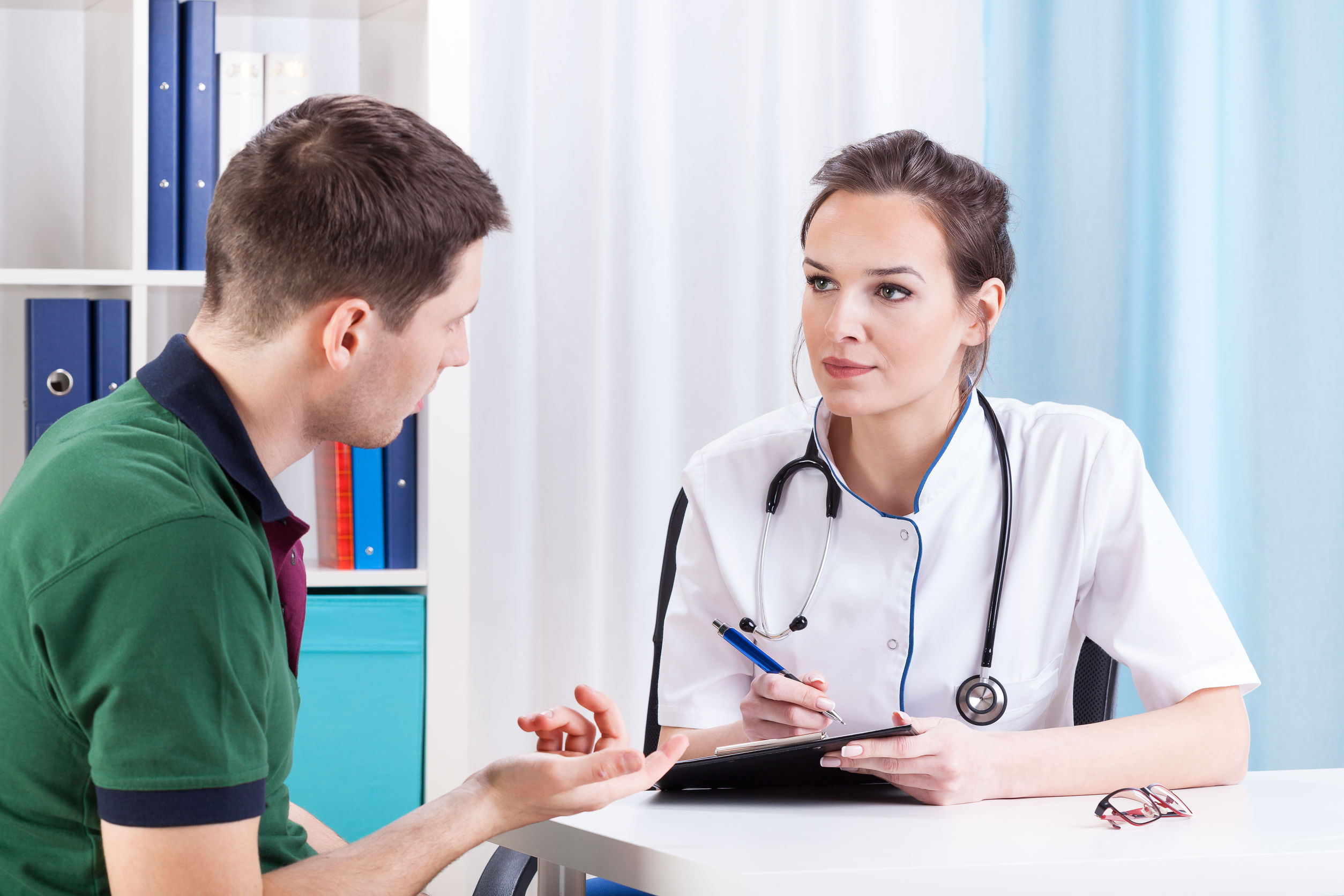A doctor and patient chatting about what doctors wish their patients knew